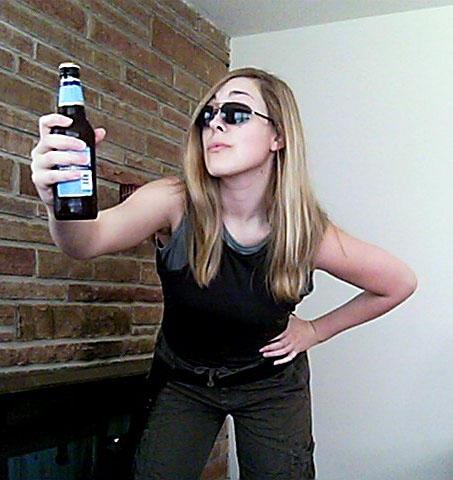 Banshee: Holding up a beer and peering at the camera through sunglasses.