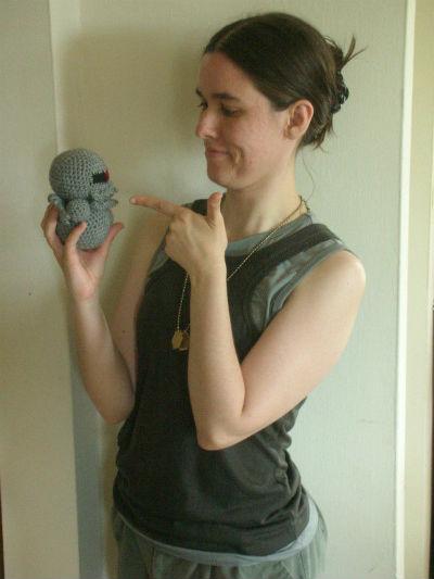 Squid: Pointing a finger-gun at a Cylon-Cthulhu hybrid doll.